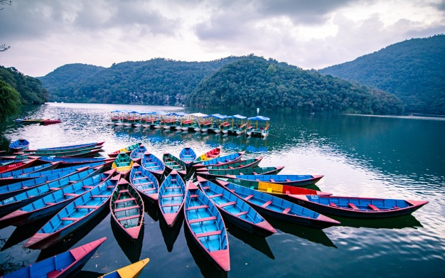 beautiful-view-colorful-boats-fewa-lake-pokhara-nepal_131480-124